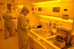 Scientists working in a clean room environment. [Image: Wikimedia/UCL Faculty of Mathematical and Physical Sciences]